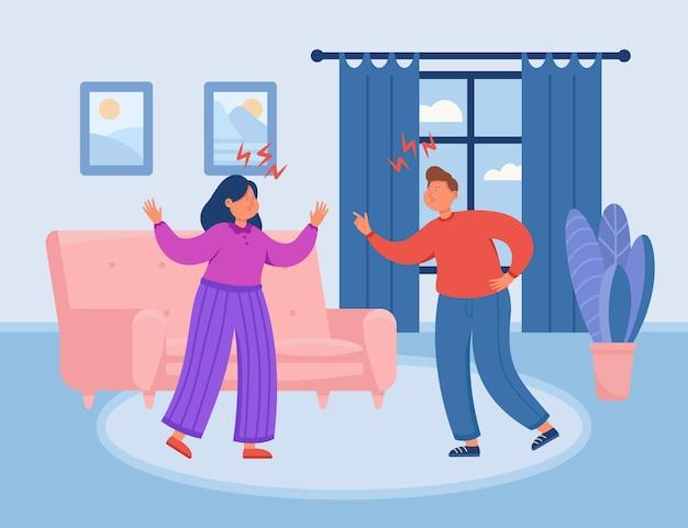 Jonge man en vrouw die thuis ruzie maken