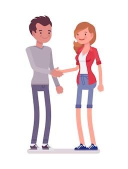 Jonge man en vrouw handenschudden