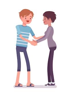 Jonge man en vrouwenhandenschudden met beide handen