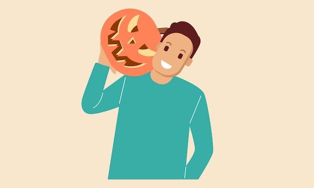 Jonge man houdt halloween pompoen hoofd