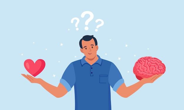 Jonge man houdt hersenen en hart in handen. kiezen tussen gevoel en geest, carrière of hobby, liefde of werk. mannelijk personage dat levensbeslissing neemt