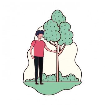 Jonge man in landschap met bomen en planten