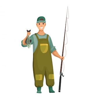Jonge man in rubberen pak en met hengel in zijn handen. gevangen vis in de hand. succesvol vissen