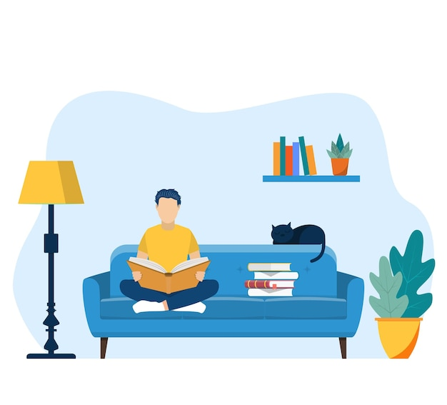 Jonge man leesboek op stoel thuis.
