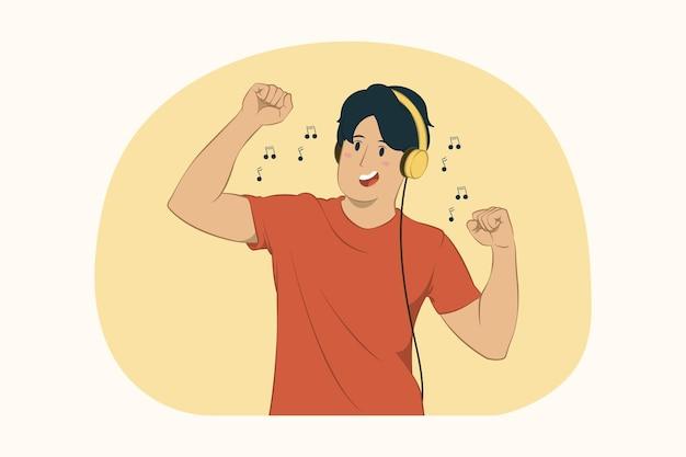 Jonge man luisteren muziek in koptelefoon dansen genieten veel plezier foolong rond concept