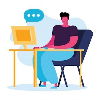 Jonge man met behulp van computer op desktop