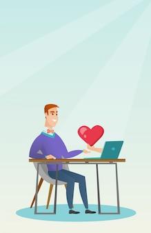 Jonge man met behulp van een laptop online dating.