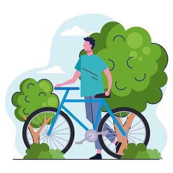 Jonge man met fiets in de illustratie van het parkkarakter Premium Vector