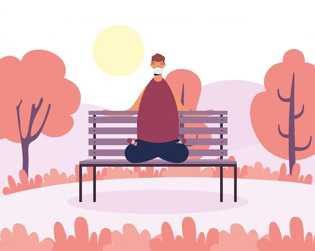 Jonge man met medische masker beoefenen van yoga in park stoel