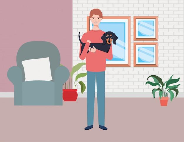 Jonge man met schattige hond mascotte in de woonkamer