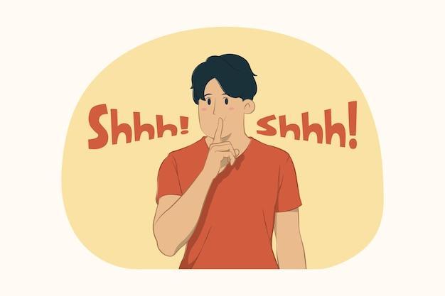 Jonge man wees stil met vinger op lippen shhh gebaar concept