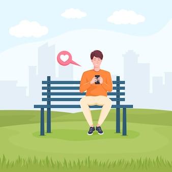 Jonge man zittend in het park op de bank en chatten op smartphone.