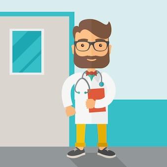 Jonge mannelijke arts die zich met stethoscoop bevindt.