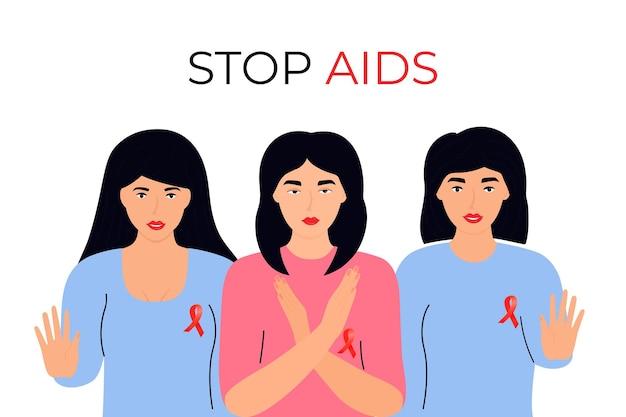 Jonge meisjes met rode linten tonen gebaar van stop aids