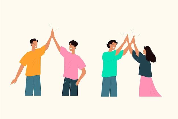 Jonge mensen die high five geven