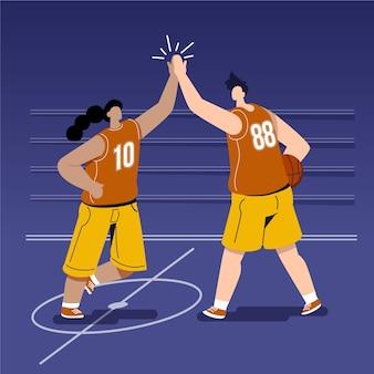 Jonge mensen die hoogte vijf op een basketbalveld geven