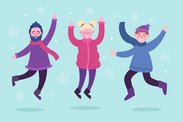 Jonge mensen dragen winterkleren pak springen