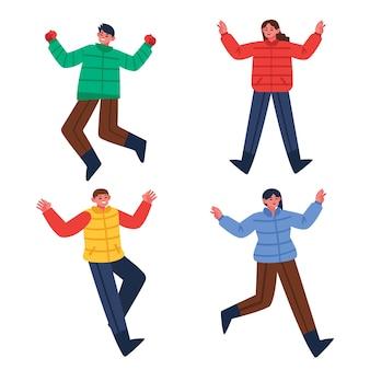 Jonge mensen dragen winterkleren springen
