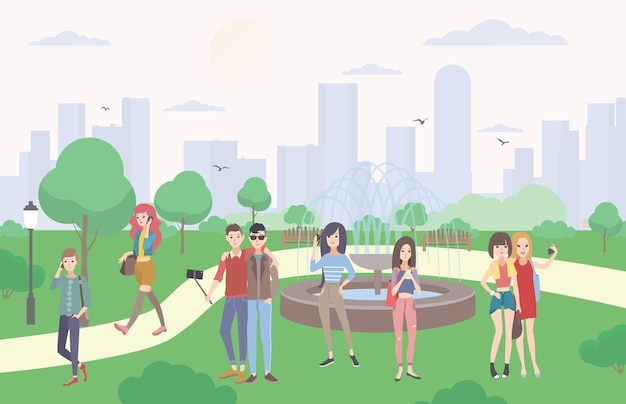 Jonge mensen met gadgets in het park