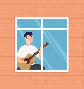 Jonge mensenverblijf die thuis gitaar in venster spelen