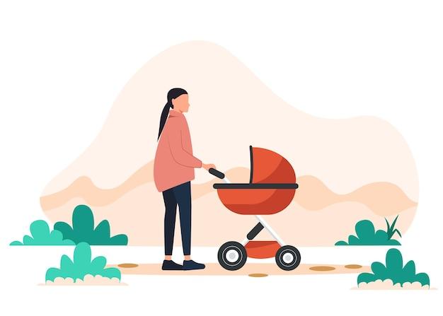Jonge moeder loopt met een kinderwagen in de park-afbeelding