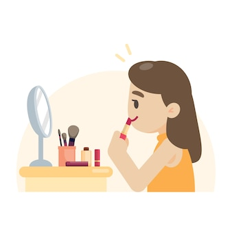 Jonge mooie vrouw die make-up maakt die haar lippen rouging