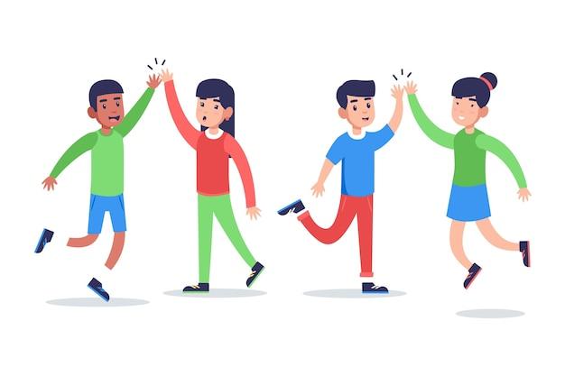 Jonge samenleving die high five geeft