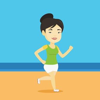 Jonge sportieve vrouw die op het strand aanstoot.
