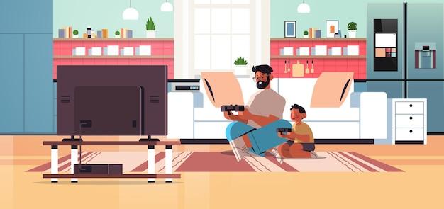 Jonge vader spelen van videogames op gameconsole met zoontje thuis ouderschap vaderschap concept vader tijd doorbrengen met zijn kind volledige lengte horizontale vectorillustratie