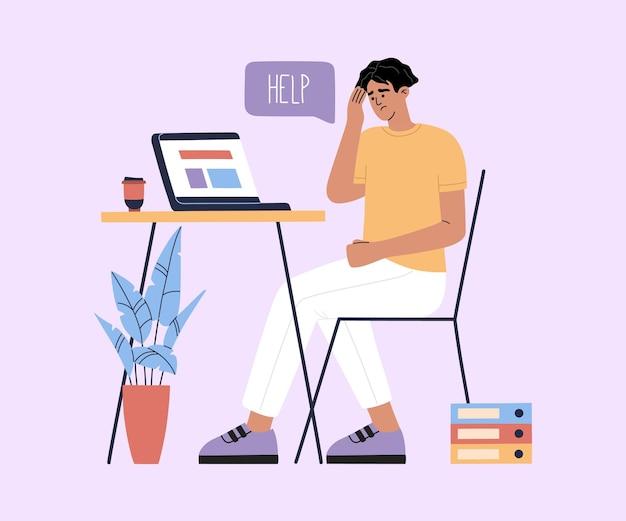 Jonge vermoeide man zit bij de tafel met laptop en heeft een kopje koffie