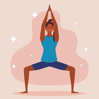 Jonge vrouw afro die yoga beoefent