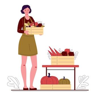 Jonge vrouw boer tuinman met dozen verse groenten en fruit.