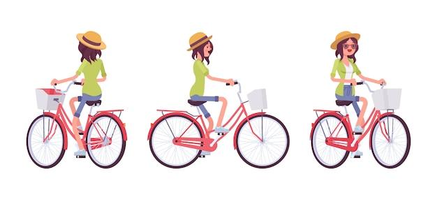 Jonge vrouw die een fiets berijdt