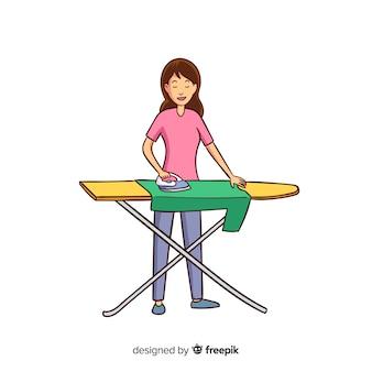 Jonge vrouw die haar kleren strijkt