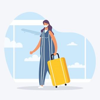 Jonge vrouw die medisch masker met koffer draagt