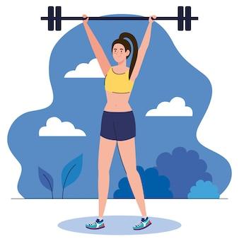 Jonge vrouw doet oefeningen met gewicht bar buiten, sport recreatie oefening