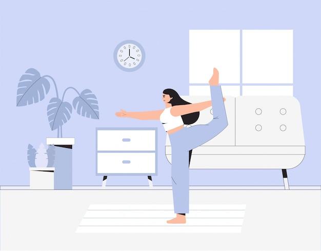 Jonge vrouw doet yoga in een gezellige kamer met een modern interieur.