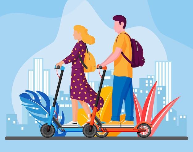 Jonge vrouw en man op kick scooter