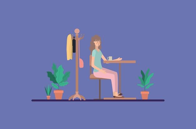 Jonge vrouw het drinken koffie op de eetkamer