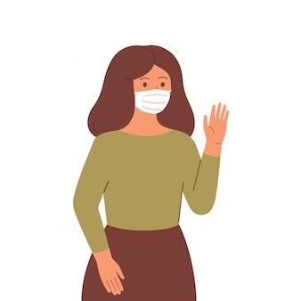 Jonge vrouw in gezichtsmasker handhaaft een sociale afstand zwaait met haar hand.