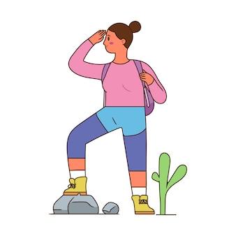 Jonge vrouw klaar voor avontuur, jonge sportieve vrouw permanent en klaar om de natuur met rugzak te verkennen