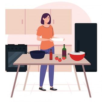 Jonge vrouw koken met houten tafel en potten, flessen en groenten