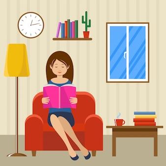 Jonge vrouw leest zittend in een stoel