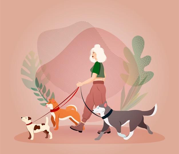 Jonge vrouw lopen honden. hondenoppas concept. dog mama. dierenzorg. werk met dieren. hondentraining. illustratie