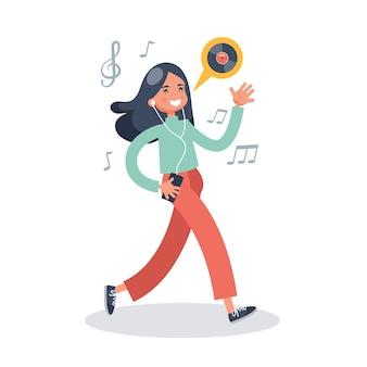 Jonge vrouw luistert naar de muziek in oortelefoons