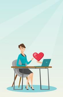 Jonge vrouw met behulp van een laptop online dating.