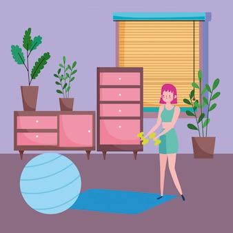Jonge vrouw met halters en fitball mat in de kamer, oefeningen thuis