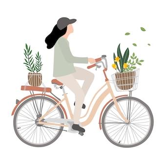 Jonge vrouw op fiets. de berijdende fiets van de vrouw met bloem.