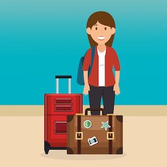 Jonge vrouw op het strand met koffer