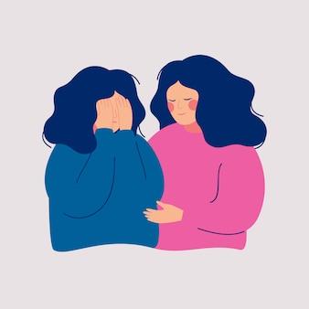 Jonge vrouw troost haar huilende beste vriend. help en ondersteuning concept.
